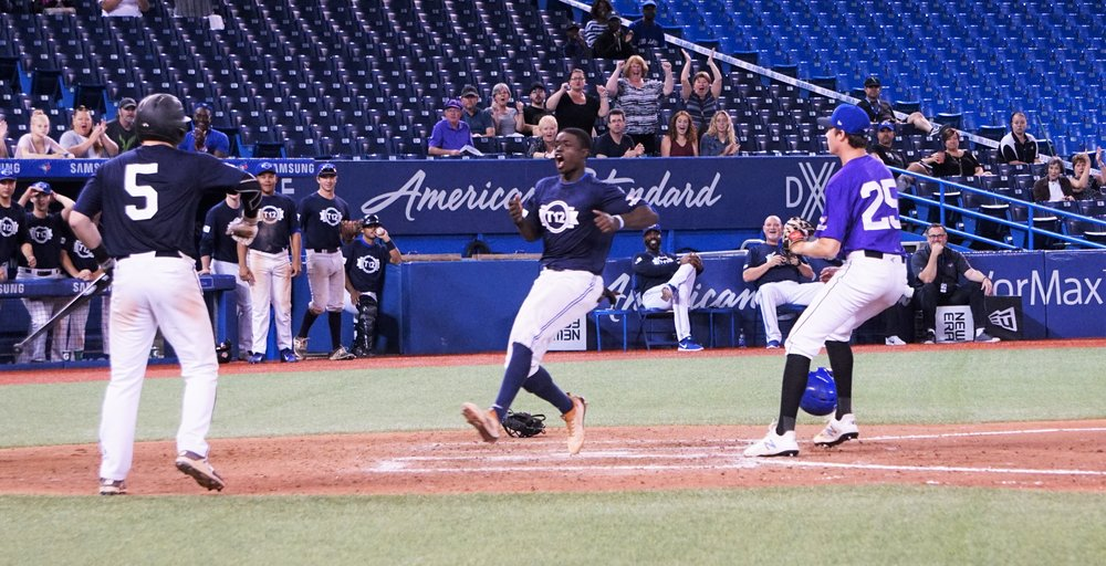 Jaden Brown (Mississauga, Ont.) scores the winning run in the Futures Navy's 2-1 victory over the Prairies on Saturday at Tournament 12 at the Rogers Centre. Photo Credit: Yoram Kerbel