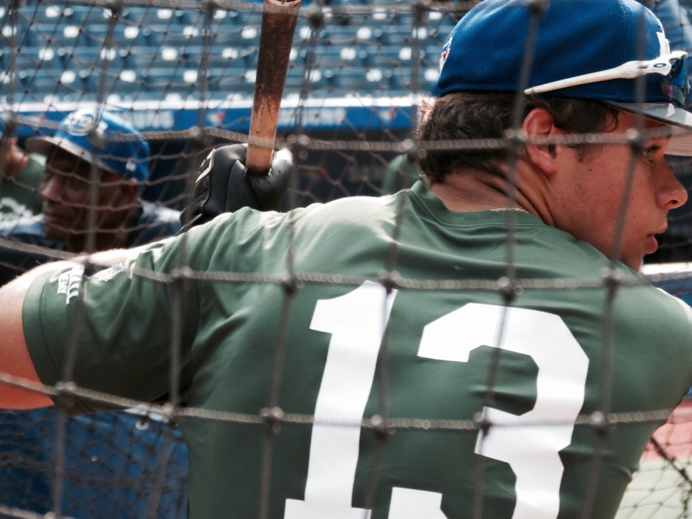 Blake Buckle, of the Ontario Blue Jays, focuses during his batting practice session on Scout Day at Tournament 12. Photo Credit: Tyler King.