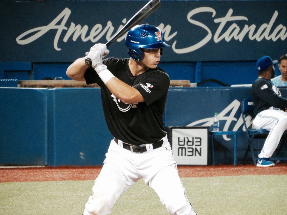 Leo Markotic, of the Toronto Mets, had a game-tying, two-run single in the bottom of the seventh inning that salvaged a tie for Ontario Black with Quebec on Saturday at Tournament 12. Photo Credit: Tyler King.