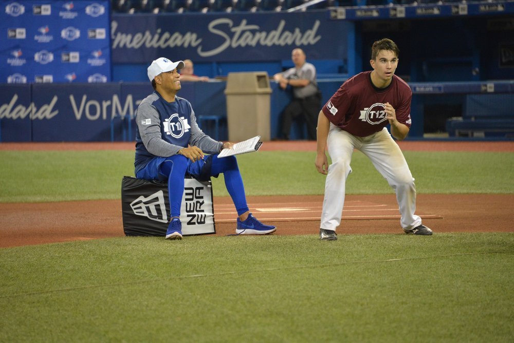 Mount Pearl, Nfld., native Cole Tucker, shown here with Roberto Alomar on Friday at the Rogers Centre, had a key two-run single as part of a six-run, fourth-inning rally for the Atlantic squad in the opening game of T12 on Sunday. Photo Credit: Tyler Partridge