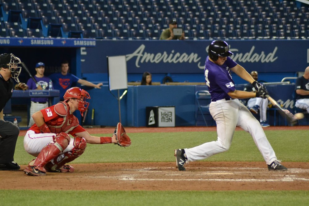 Zach Giesbrecht (Landmark, Man.) makes contact for Prairies Purple in their final T12 matchup against Alberta on Sunday. Giesbrecht produced a two-run single in the 12-5 victory. Photo Credit: Jose Taboada