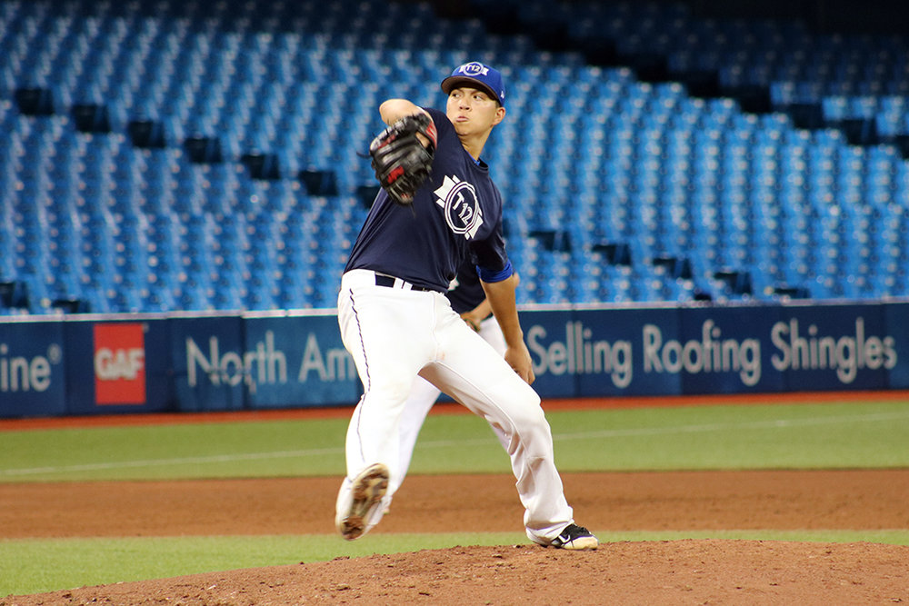 Futures Navy pitcher Justin Thorsteinson, of the Langley Blaze, pitches against the Atlantic squad at Rogers Centre on Thursday. He has committed to play for the Oregon State Beavers in 2020 after he graduates high school. Photo Credit: Austin Owens