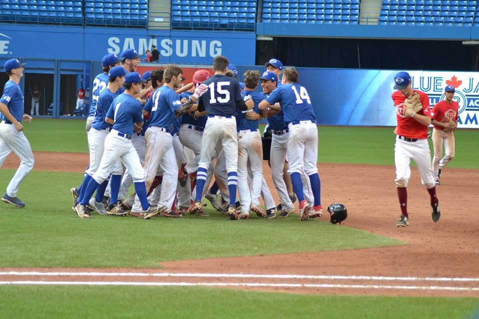Team Quebec celebrates advancing to the T12 Finals after a walk-off single by Jason Begin. Photo Credit: Jose Taboada