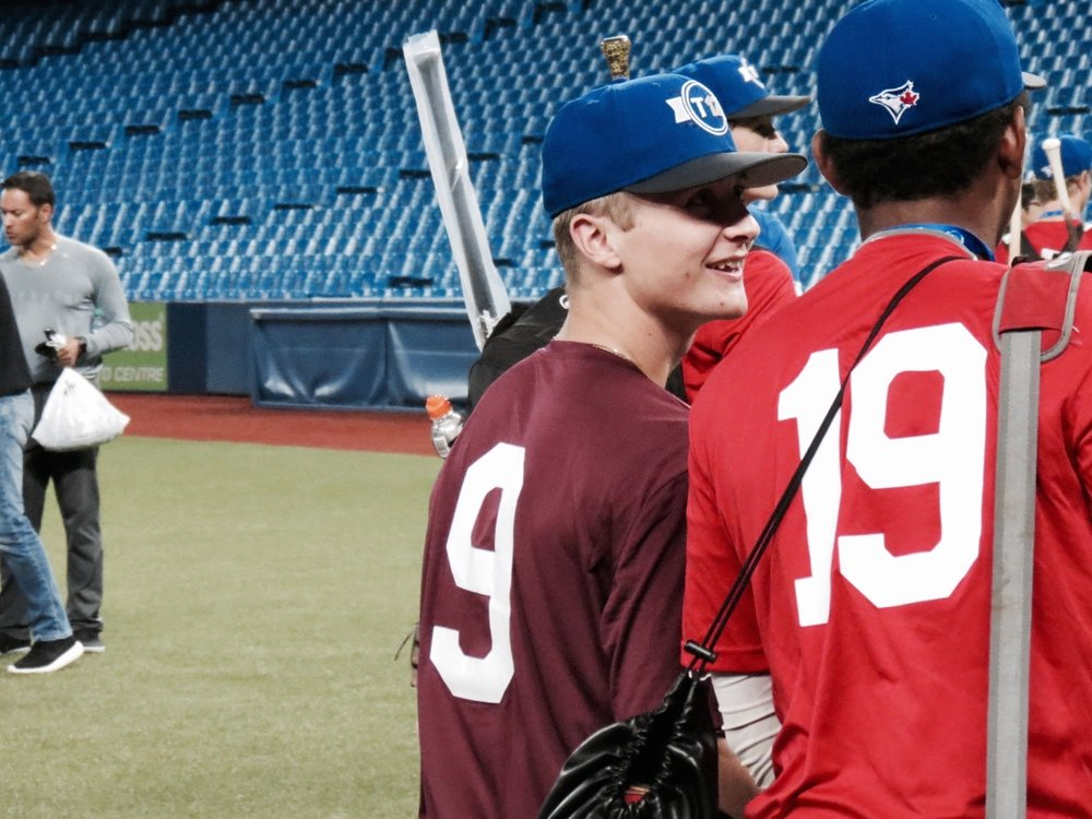 Ethan Francis (Miscouche, P.E.I), of the Okotoks Dawgs Baseball Academy, (No. 9 in photo) pitched in his second Tournament 12 at the Rogers Centre this past weekend. Photo Credit: Tyler King