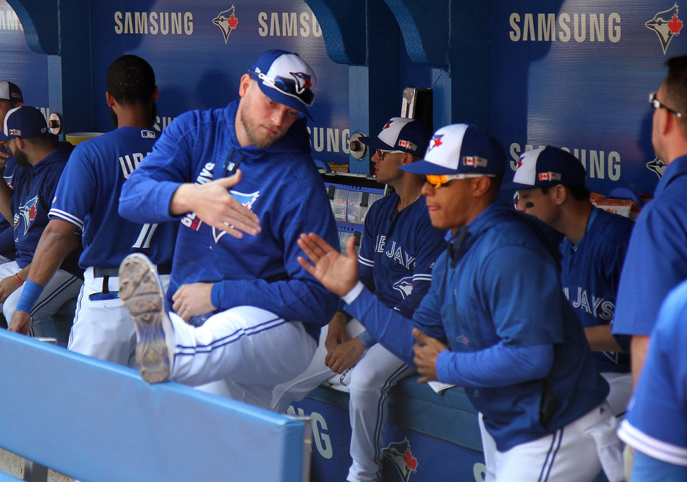 """Toronto Blue Jays outfielder Michael Saunders (Victoria, B.C.) high fives pitcher Marcus Stroman in the dugout. Photo Credit: Matt Antonacci       Normal   0           false   false   false     EN-CA   X-NONE   X-NONE                                                                                                                                                                                                                                                                                                                                                                                          /* Style Definitions */  table.MsoNormalTable {mso-style-name:""""Table Normal""""; mso-tstyle-rowband-size:0; mso-tstyle-colband-size:0; mso-style-noshow:yes; mso-style-priority:99; mso-style-qformat:yes; mso-style-parent:""""""""; mso-padding-alt:0cm 5.4pt 0cm 5.4pt; mso-para-margin:0cm; mso-para-margin-bottom:.0001pt; mso-pagination:widow-orphan; font-size:10.0pt; font-family:""""Times New Roman"""",""""serif""""; mso-fareast-font-family:""""Times New Roman"""";}"""