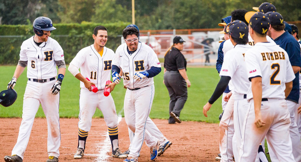 The Humber Hawks celebrate after their walk-off win against the Durham Lords in the second game of Saturday's doubleheader. Photo Credit: Humber Athletics