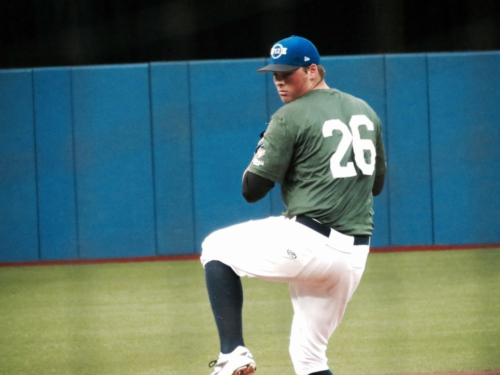 RHPs Ben Abram (Georgetown, Ont.), shown here with Ontario Green at Tournament 12, pitched four scoreless for the Toronto Blue Jays Scout Team at Jupiter, Flaa. Photos: Tyker king.