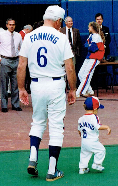 Expos manager Jim Fanning -- No. 6 in the programm, No. 1 in many fans' hearts -- at Olympic Stadium on father and son day.