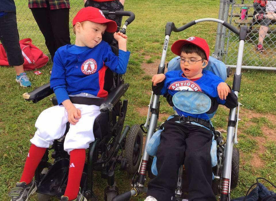 Seven-year-old Cullan Chisholm (left) at Challenger Baseball in Antigonish, N.S., with his friend, Will. Photo Credit: Wade Chisholm