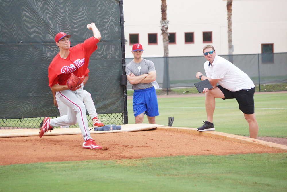 Roy Halladay, right, watches Phillies pitching prospect Tom Windle at the Carpenter Complex Friday in Clearwater. A two-time Cy Young award winner with the 2003 Jays and the 2010 Phillies is a special assistant with the Phillies. Windle was a second round pick of the Los Angeles Dodgers in 2013. Photo: Eddie Michels.