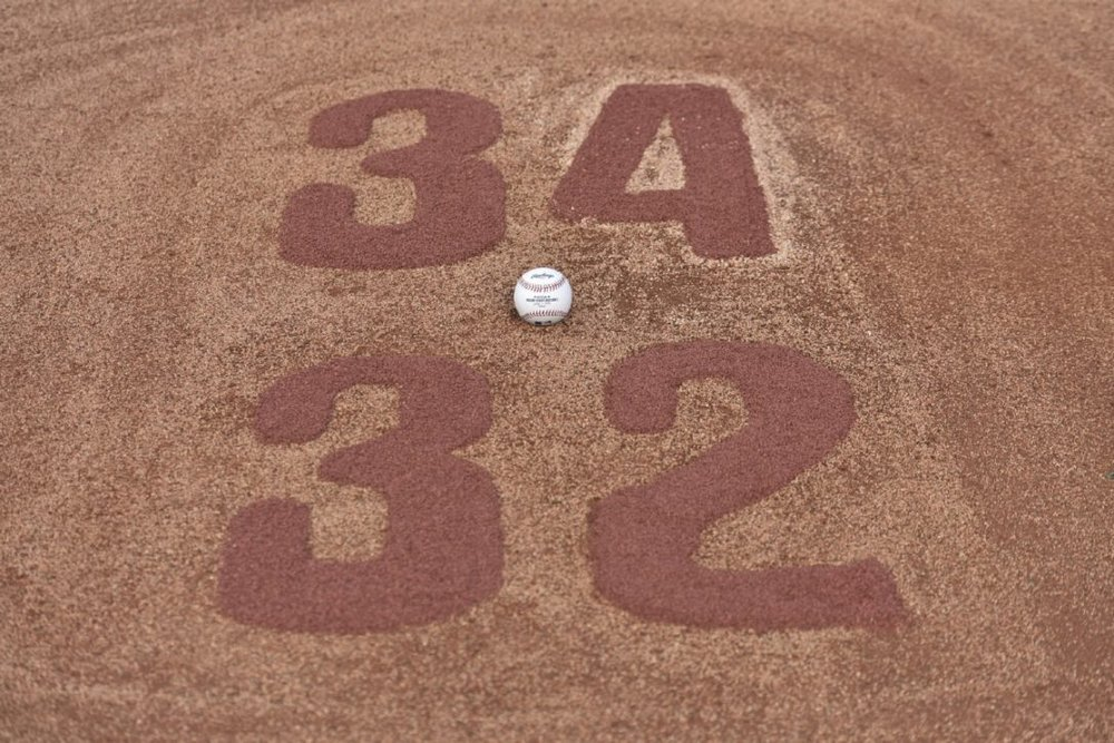 The numbers on the mound were a tribute to Halladay and the uniforms he wore with the Phillies and Blue Jays. Photo: Steve Nesius.