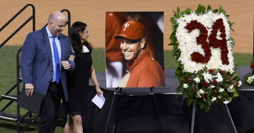 Phillies announcer Tom McCarthy takes Brandy McCarthy to her seat after her emotional speech. Photo: Chris Urso, AP.