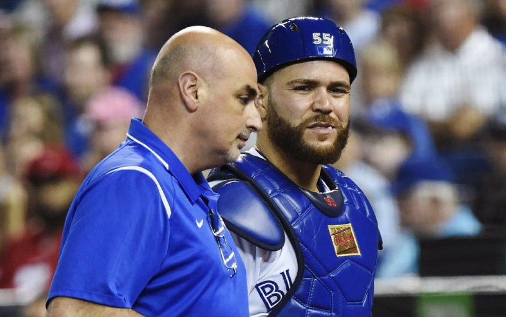 Longtime Toronto Blue Jays trainer George Poulis, shown here with Russell Martin (Montreal, Que.), has left the club to become the Atlanta Braves head trainer. Photo Credit: Nathan Denette, Canadian Press