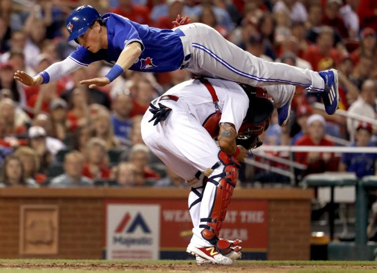 Chris Coghlan authored one of the memorable plays of the Toronto Blue Jays' season when he leapt over St. Louis Cardinals catcher Yadier Molina in a game on April 25 to score. Photo Credit: Jeff Roberson, AP