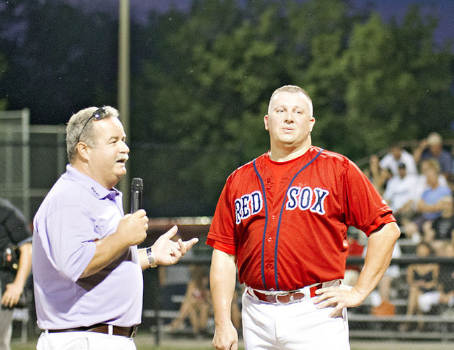 Brantford owner Paul Aucoin congratulates Kevin Hinton on becoming the all-time hit leader in 2012. Hinton now sits second in games (758), hits (790), doubles (141) and RBIs (517). He is fourth in homers and 11th in triples. In his 27 seasons he hit .287, was a seven-time all-star and earned co-playoff MVP honours in 2003. Photo Kara Wilson.