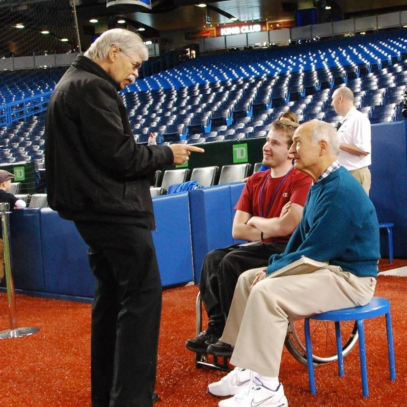 Jonathan Hodgson enjoys a conversation with Jerry Howarth, and Bob Elliott at Rogers Centre. Photo Credit: Jonathan Hodgson