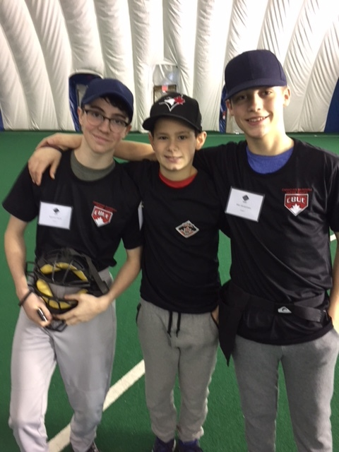 Colin Uba, 14, (centre) was joined by his friends at the recent Canadian Baseball Umpire Camp. Photo Credit: Scott Langdon
