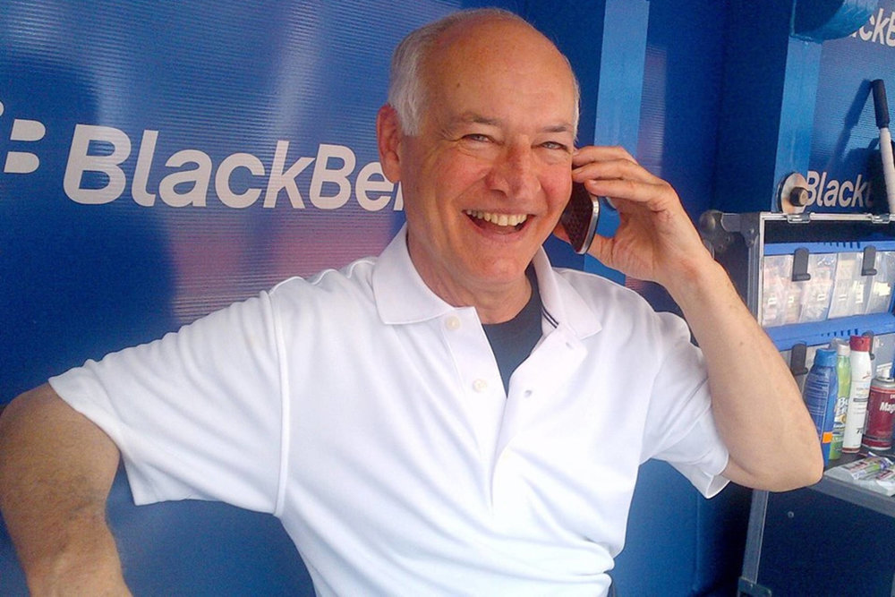 Blue Jays broadcaster Jerry Howarth in a rare shot of him using the cell phone. Photo: Stenhouse Studios.
