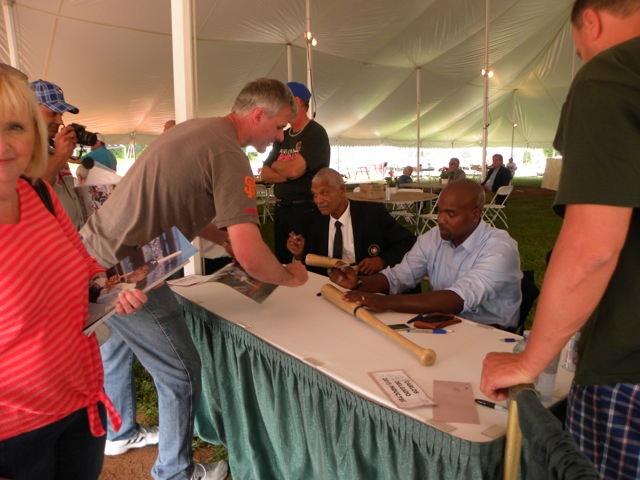 Inductees Felipe Alou and Carlos Delgado sign autographs for fans on the Canadian Baseball Hall of Fame's induction weekend in 2015. Photo Credit: Canadian Baseball Hall of Fame