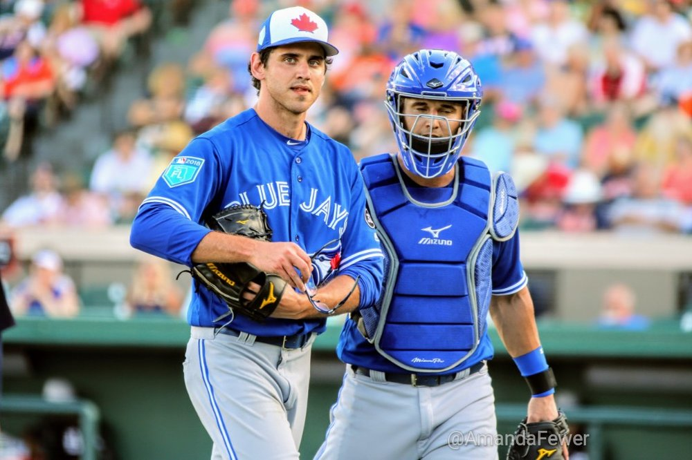 Romano receives a pat on the back from Blue Jays catching prospect Max Pentecost during Saturday's game.