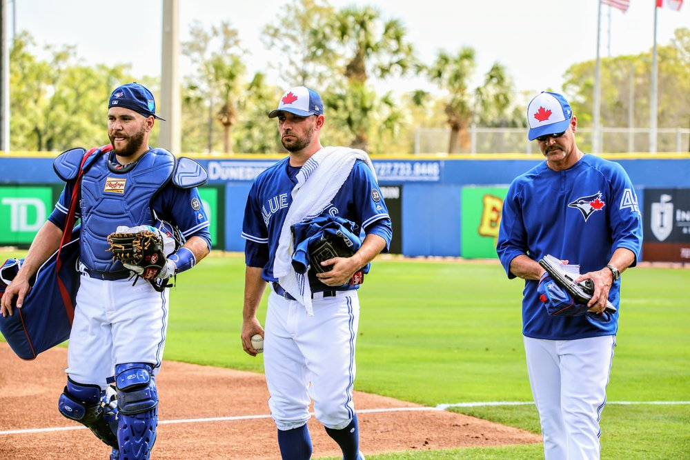 Russell Martin (Montreal, Que.), right-hander Marco Estrada and Blue Jays pitching coach Pete Walker stroll in from the bullpen prior to the game.