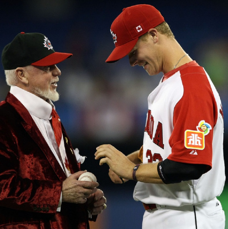 Don Cherry after throwing out the first pitch in 2009 and Morneau.