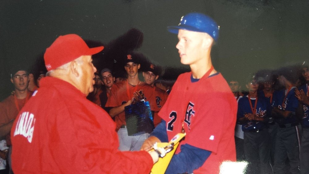 The late Art Berard presenting best hitter honours to Morneau in Red Deer