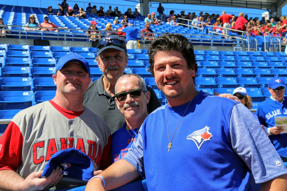 Saint John, N.B., native Andrew Case (right) met up with his dad, Jade McDermott, wearing the Canada uniform  and uncles at Dunedin Stadium on Saturday.