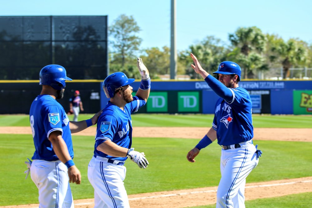 Montreal native Russell Martin (centre) followed up Pillar's home run with a three-run shot of his own in the fifth inning. In this photo, Martin is congratulated by Kendry Morales (left) and Justin Smoak after his blast.