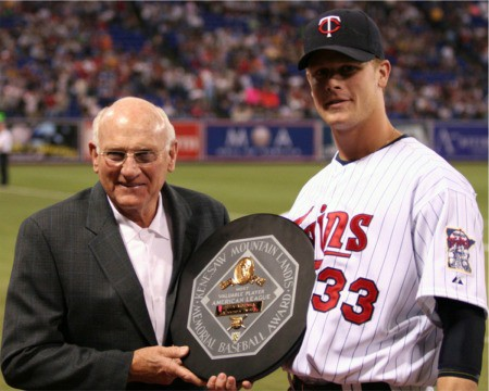 The late Harmon Killebrew, left, preseents Morneau  with his MVP award