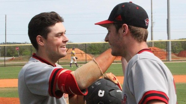 Central Ontario Reds grad OF Zac Wilson (New Lowell, Ont.) accepts congrats after crossing hhome plate.