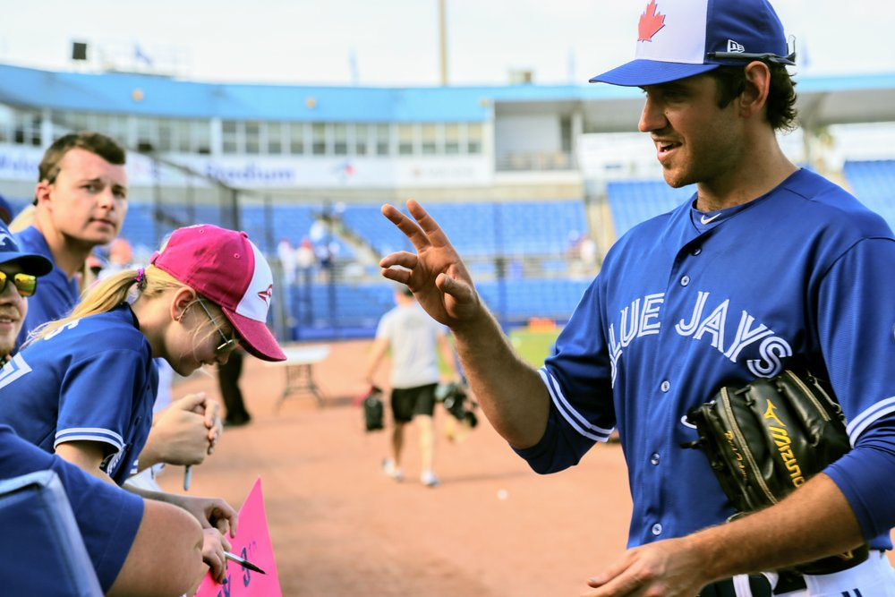 Markham, Ont., native Jordan Romano interacts with the fans at Dunedin Stadium.