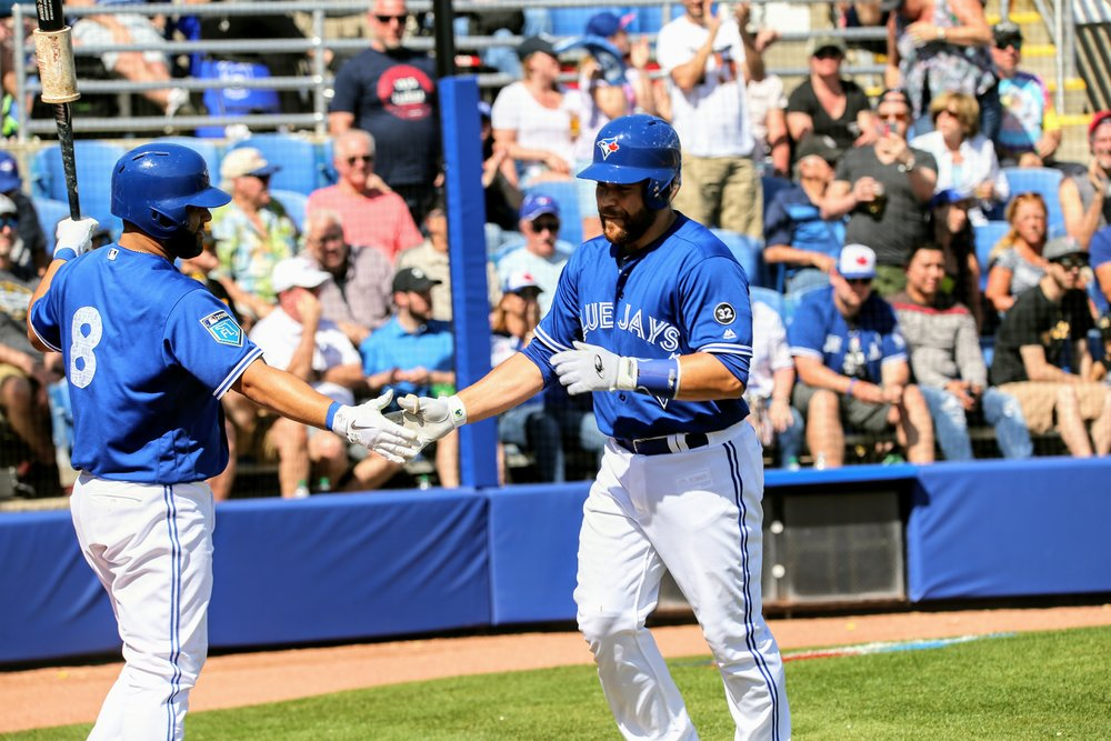 Montreal native Russell Martin (right) celebrates with Kendrys Morales after the Canadian clubbed his third home run of the spring. Martin started at third base.