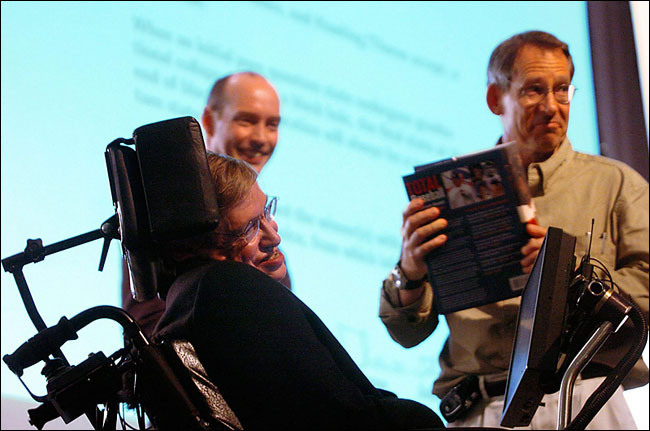 Dr. Stephen Hawking presents the Toronto published Total Baseball to Dr. John Preskill in Dublin in 2004.