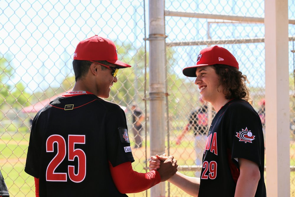 Shortstop Cesar Valero (Calgary, Alta.), on the left, perhaps practicing a new handshake with right-hander Zack McQuaid (Oshawa, Ont.)
