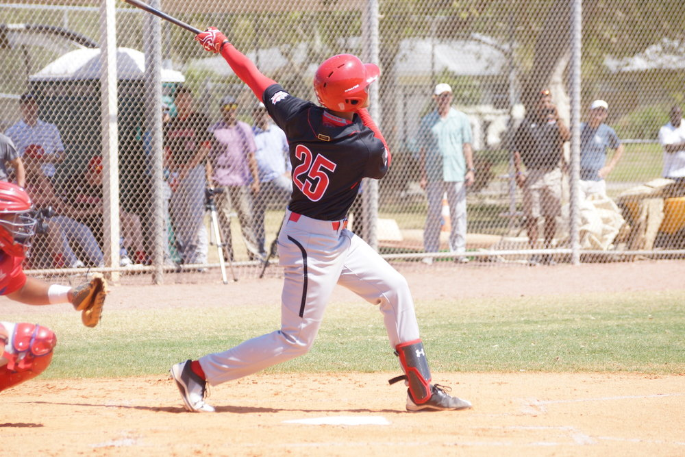 Cesar Valero (Calgary, Alta.), of the Okotok Dawgs Baseball Academy, belted the first home run of the spring for the Canadian National Junior Team on Sunday. Photo Credit: Eddie Michels