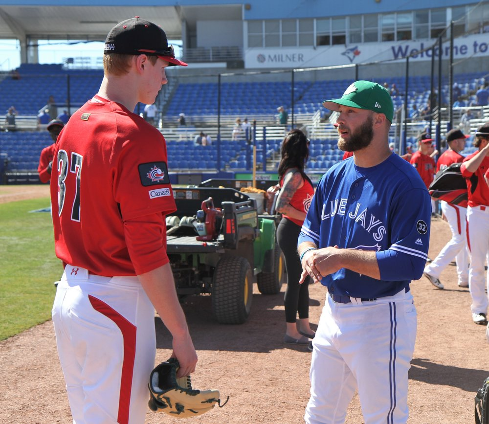 Blue Jays minor league pitcher Shane Dawson (Drayton Valley, Alta.) (on the right) gave Cerantola some pointers after the game. Photo Credit: Matt Antonacci