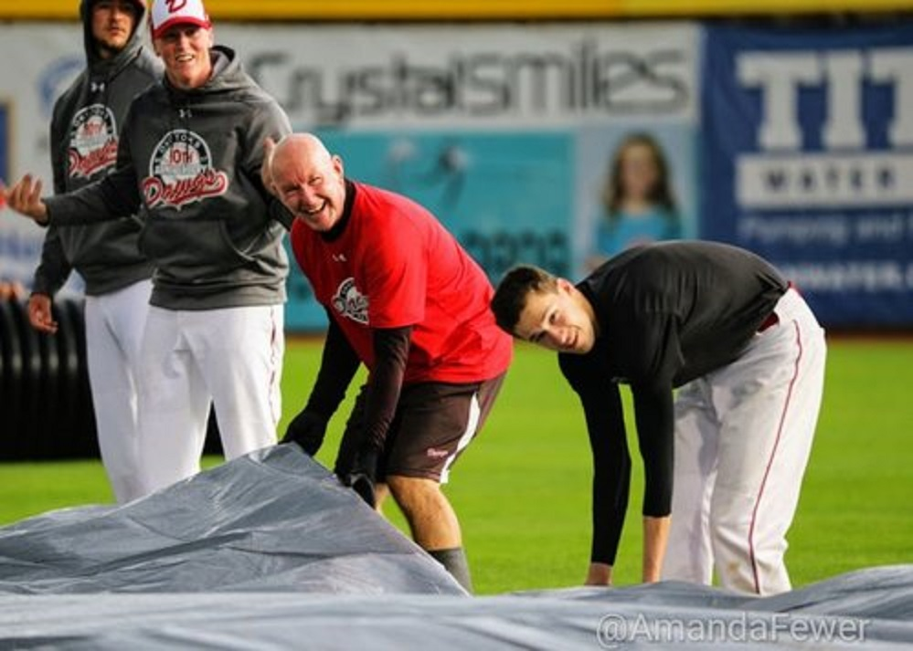 No job around the ball park is too big for Dawgs coach Dave Robb, whether it is hitting ground balls or fixing the tarp. Photo: Amanada Fewer.