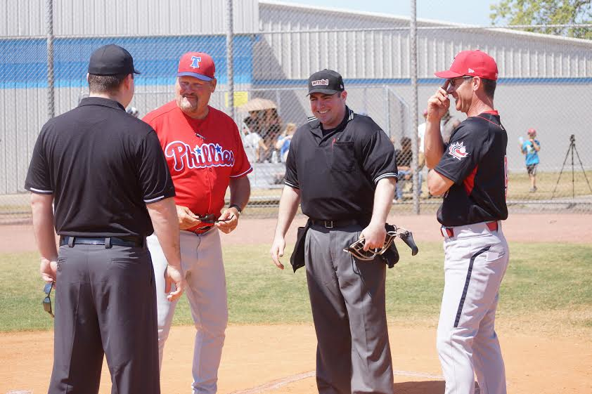 Ernie Whitt, left and Greg Hamilton shared many a dugout as Canada played in international competitions and Sunday they shared a laugh at home plate. Photo: Eddie Michels.