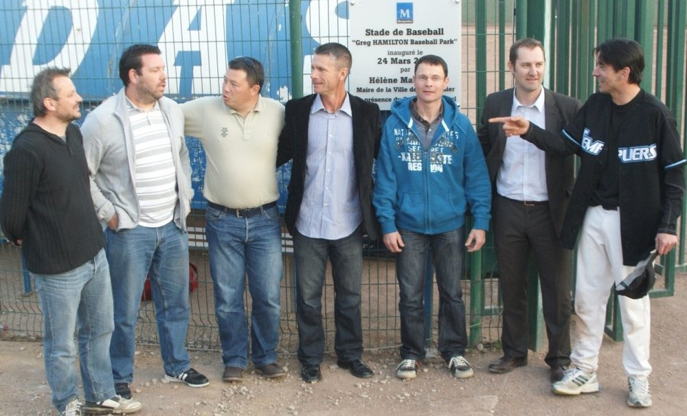 Greg Hamilton, blue shirt, middle, during 2012 ceremonies when the Montpellier Barracudas in France re-named their ball field after Hamilton. He had coached the Cudas.