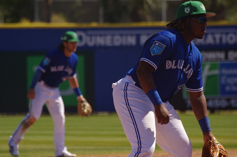 Toronto Blue Jays prospects Bo Bichette (background) and Vladimir Guerrero Jr. (Montreal, Que.) manned the left side of the Toronto Blue Jays' infield in the club's game against the Canadian Junior National Team on Saturday at Dunedin Stadium. Photo Credit: Jay Blue
