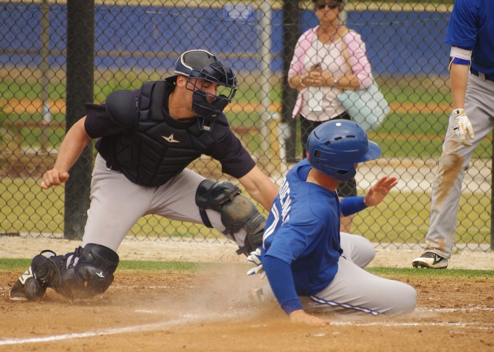 Toronto Blue Jays infield prospect J.C. Cardenas slides into home in a game on Monday at the Bobby Mattick Trainer Center in Dunedin, Fla. Photo Credit: Jay Blue