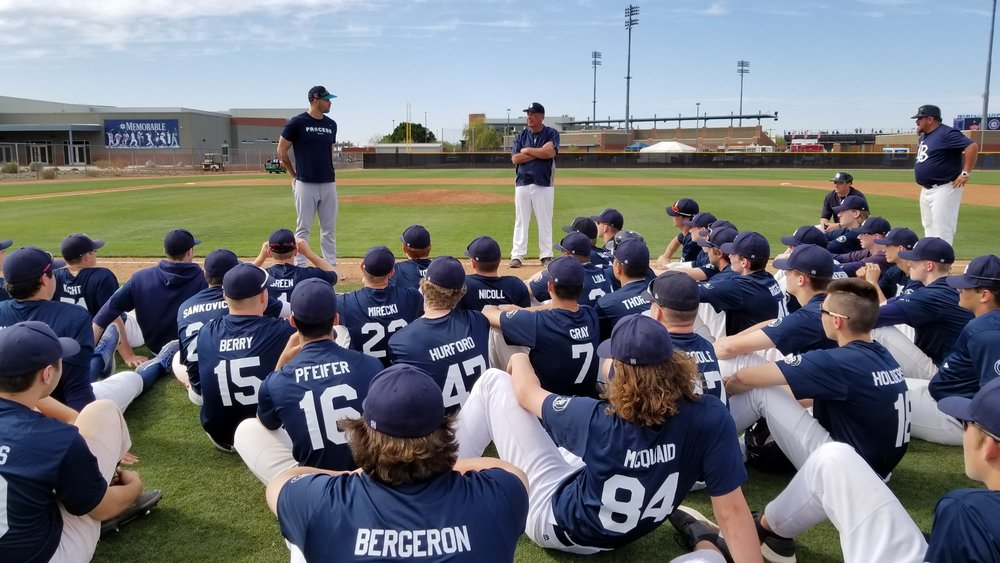 Seattle Mariners LHP James Paxton (Ladner, BC), left, stands with Langley coaches Doug Mathieson and Junior Deleon as Paxton speaks to the Langley Blaze after the Wayne Norton Memoriall game against the Mariners' first and second-year pros.