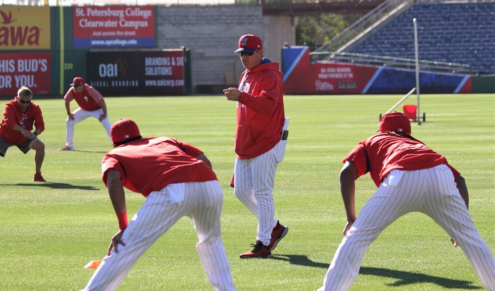 Thomson (middle) chats with Phillies players during their morning workout in Clearwater, Fla. Photo Credit: Matt Antonacci