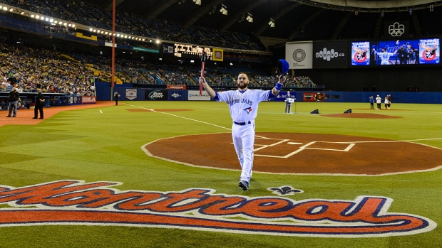 Montreal native Russell Martin acknowledges an ovation at a Toronto Blue Jays pre-season game at Montreal's Olympic Stadium. Photo Credit: Minas Panagio/Getty Images