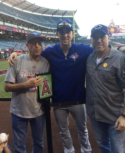 Blue Jays ace Aaron Sanchez, centre, with father Mike Shipley, left, and Mike Hansford (Oakville, Ont.) before a game in Anaheim. (Submitted by Mike Hansford)