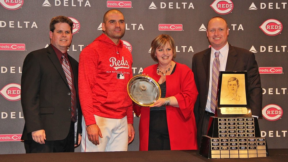 A team of representatives from the Canadian Baseball Hall of Fame presented Joey Votto (Etobicoke, Ont.) with the Hall's Tip O'Neill Award prior to the Cincinnati Reds game at Great American Ballpark on Friday. To read more about the award, you can follow this  link . From left to right in the photo: Scott Crawford, Hall's director of operations; Votto; Tammy Adkin, Hall board member and Scott Walsh, long-time Hall volunteer. Photo Credit: Canadian Baseball Hall of Fame/Cincinnati Reds.