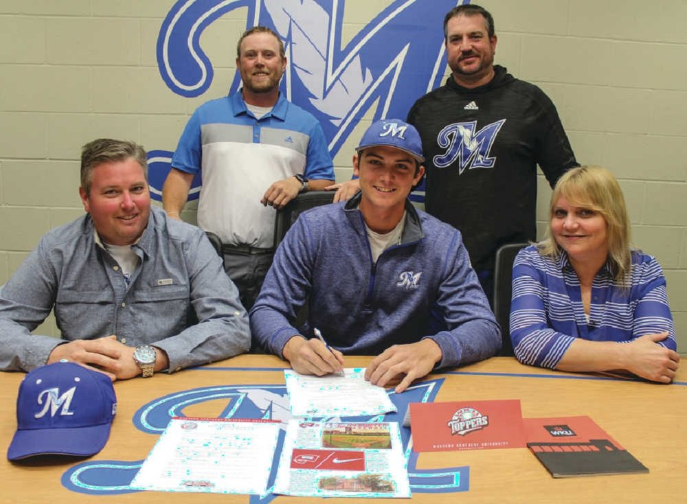 McCook Community College sophomore Jake Sanford (centre) signed a national letter of intent to continue his schooling next year at Division 1 Western Kentucky. He was joined Thursday by his parents from Dartmouth, NS, Tim (left) and Karina, and (back row) assistant coach Brady Heinz and coach Jon Olsen. Photo: Brent Cobb, MCC Athletics