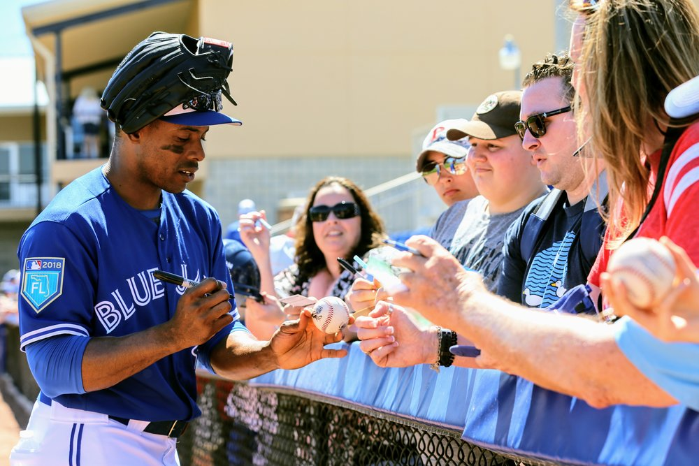 Curtis Granderson signs autographs for fans at Dunedin Stadium during spring training. Photo Credit: Amanda Fewer
