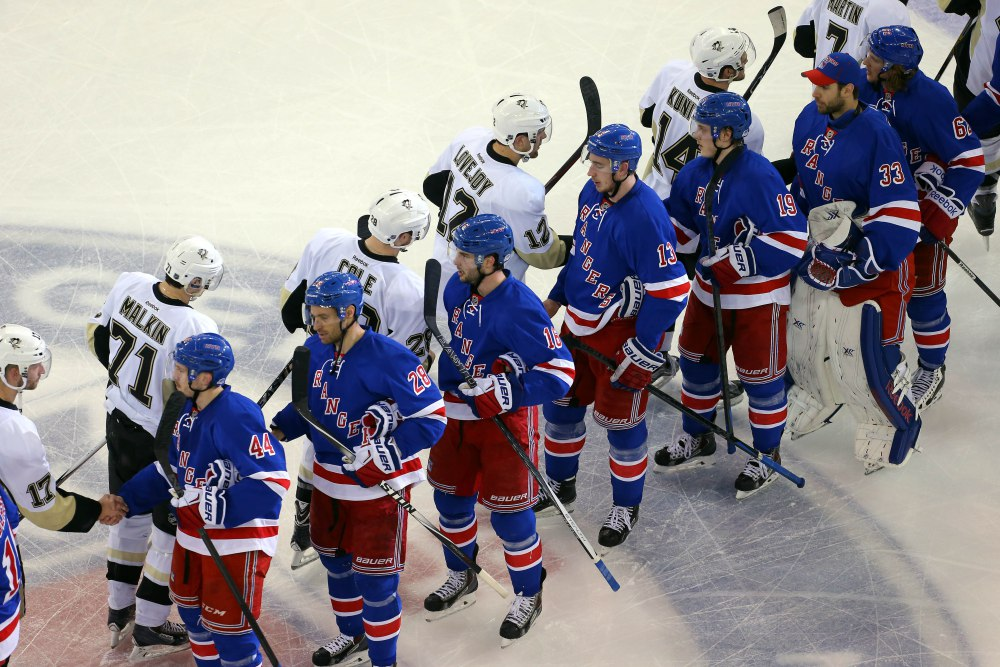 The NHL's Pittsburgh Penguins and New York Rangers players shake hands after a playoff series. Photo Credit: USA Today